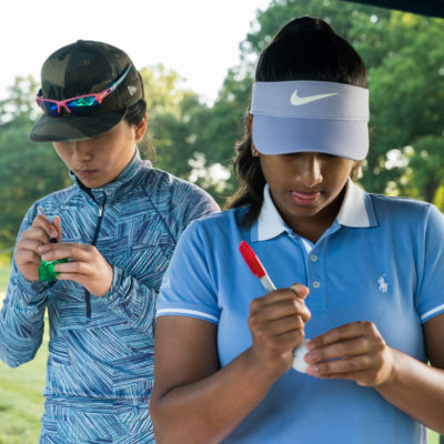 HARTFORD, CT - July 9: Coco Yang (l) and Megha Ganne (r) mark their golf balls at the first tee during the first round of the 44th Girls Junior PGA Championship held at Keney Park Golf Course on July 9, 2019 in Hartford, Connecticut. (Photo by Darren Carroll/PGA of America)