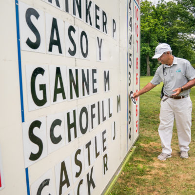 HARTFORD, CT - July 11: A volunteer updates the scoreboard at the first hole during the third round of the 44th Girls Junior PGA Championship held at Keney Park Golf Course on July 11, 2019 in Hartford, Connecticut. (Photo by Darren Carroll/PGA of America)