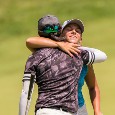 HARTFORD, CT - July 12: Jensen Castle embraces Yuka Saso  at the 18th hole during the final round of the 44th Girls Junior PGA Championship held at Keney Park Golf Course on July 12, 2019 in Hartford, Connecticut. (Photo by Darren Carroll/PGA of America)