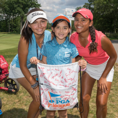 HARTFORD, CT - July 12: Alexa Pano (l) and Amari Avery (r) pose with a PGA Junior League player during the final round of the 44th Girls Junior PGA Championship held at Keney Park Golf Course on July 12, 2019 in Hartford, Connecticut. (Photo by Darren Carroll/PGA of America)