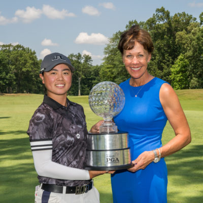 HARTFORD, CT - July 12: PGA of America President Suzy Whaley presents the Patty Berg Trophy to Yuka Saso following the final round of the 44th Girls Junior PGA Championship held at Keney Park Golf Course on July 12, 2019 in Hartford, Connecticut. (Photo by Darren Carroll/PGA of America)