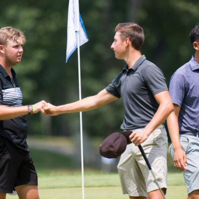 HARTFORD, CT - JULY 31: Canon Claycomb and Brett Roberts shake hands on the ninth hole during the second round for the 44th Boys Junior PGA Championship held at Keney Park Golf Course on July 31, 2019 in Hartford, Connecticut. (Photo by Hailey Garrett/PGA of America)
