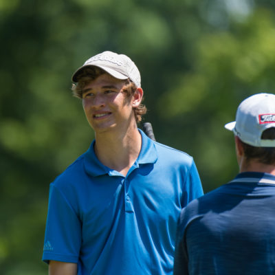 HARTFORD, CT - AUGUST 1: Jason Quinlan and Braedon Wear speak on the fifth hole during the third round for the 44th Boys Junior PGA Championship held at Keney Park Golf Course on August 1, 2019 in Hartford, Connecticut. (Photo by Hailey Garrett/PGA of America)