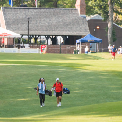 HARTFORD, CT - AUGUST 2: Jake Beber-Frankel and Canon Claycomb walk towards the first green during the final round of the 44th Girls Junior PGA Championship held at Keney Park Golf Course on August 2, 2019 in Hartford, Connecticut. (Photo by Hailey Garrett/PGA of America)