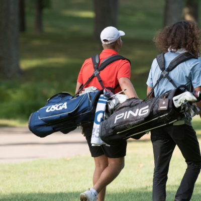 HARTFORD, CT - AUGUST 2: Canon Claycomb and Jake Beber-Frankel walk towards the second fairway during the final round of the 44th Girls Junior PGA Championship held at Keney Park Golf Course on August 2, 2019 in Hartford, Connecticut. (Photo by Hailey Garrett/PGA of America)