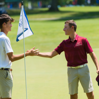 HARTFORD, CT - AUGUST 2: Jack Heath and Brett Roberts shake hands on the 18th hole during the final round of the 44th Boys Junior PGA Championship held at Keney Park Golf Course on August 2, 2019 in Hartford, Connecticut. (Photo by Hailey Garrett/PGA of America)